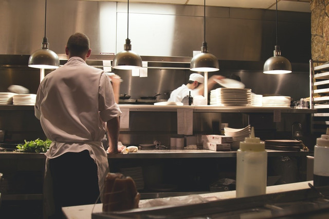 An image of chefs at work in the back of house