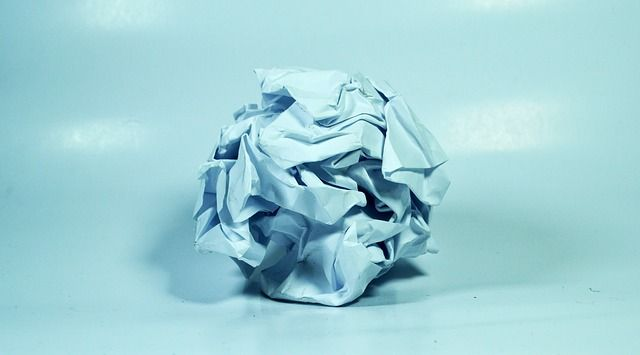 An image of crumpled paper, a common side effect of writer's block.