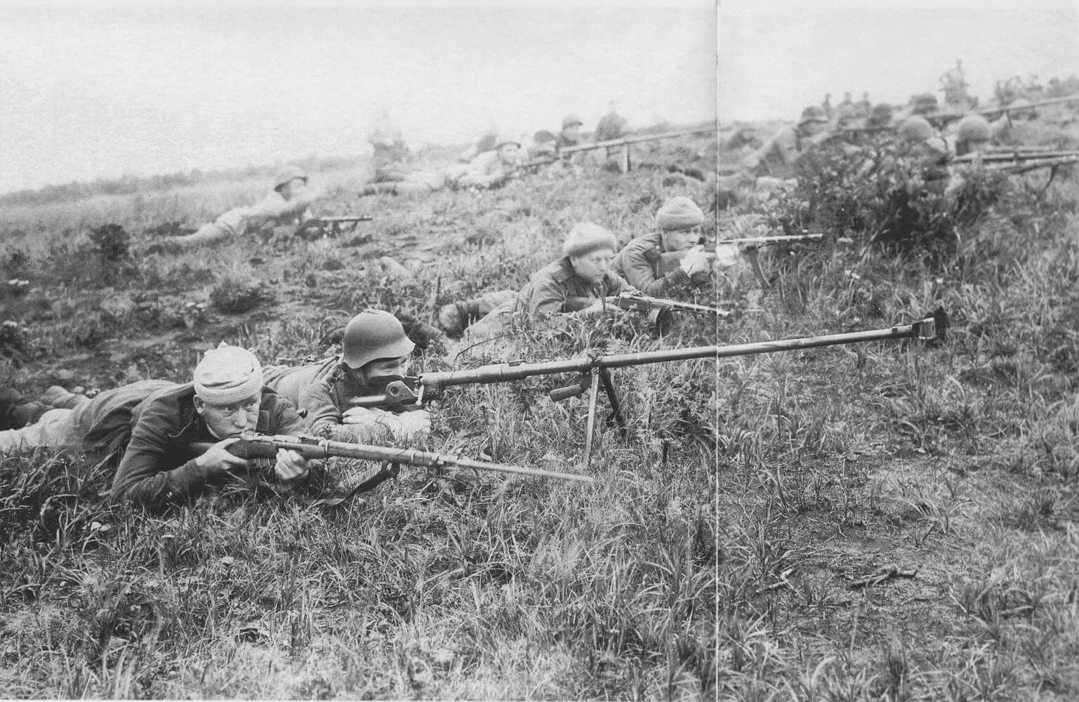Soviet soldiers with anti-tank rifles in position.