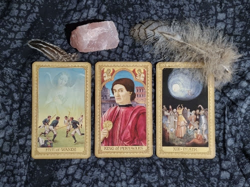 An image of three tarot cards laid out in a spread.
