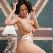 burning-hot-babe-pammie-lee-strips-down-slowly-and-displays-her-big-tits-and-perfectly-trimmed-pussy