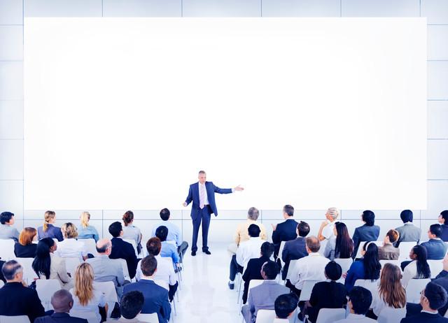 Diverse-Business-People-Conference-Speaker-Concept.jpg