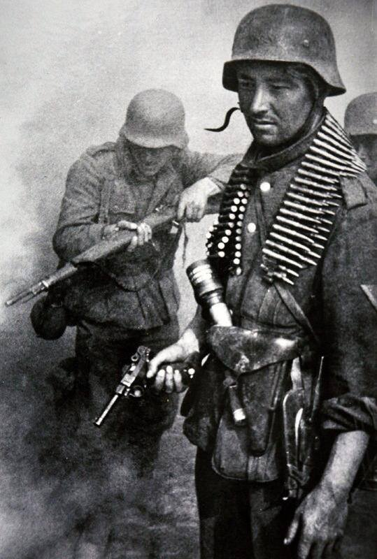 German soldiers on the eastern front. The soldier in the foreground is armed with a parabelum pistol. ww2