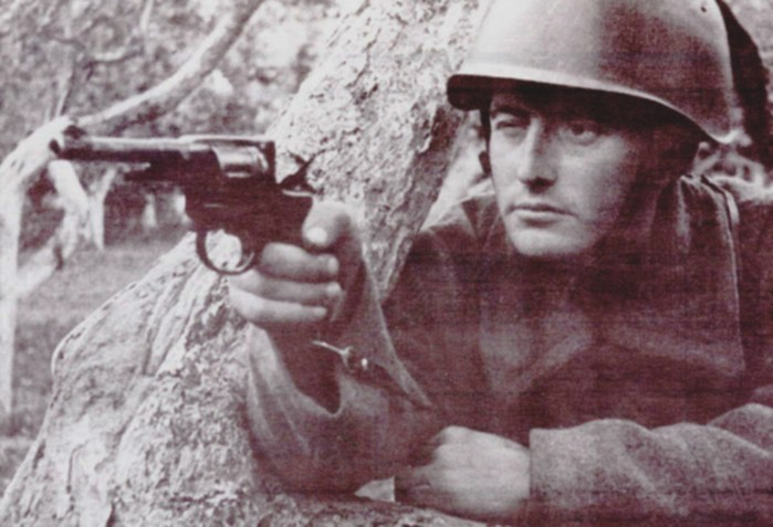 Soviet soldier in a trench with a revolver Nagant М1895