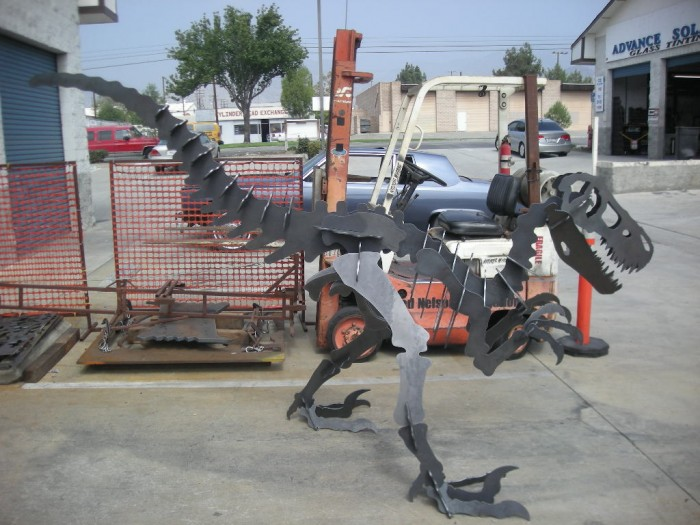 laser cut steel Raptor dinosaur garden art sculpture