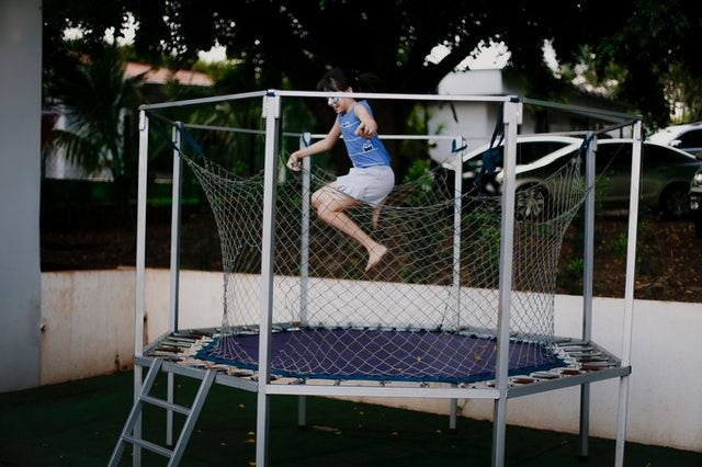girl-jumping-on-a-trampoline-4005333
