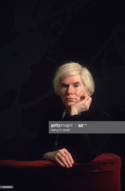 1981-American-artist-Andy-Warhol-1928-1987-sitting-in-a-red-velvet-chair-with-his-chin-propped-on-hi.jpg