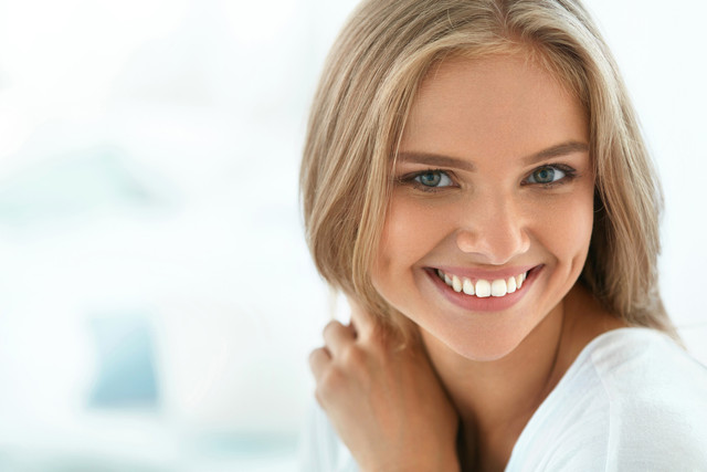 Beautiful-Woman-Smiling-Portrait-Of-Attractive-Happy-Healthy-Girl-With-Perfect-Smile-White-Teeth-Blo