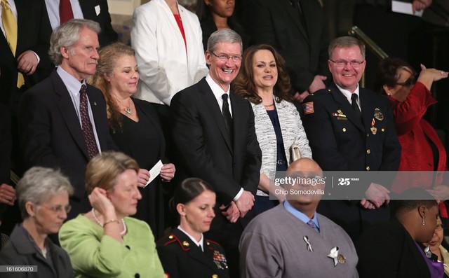 WASHINGTON-DC-FEBRUARY-12-Apple-CEO-Tim-Cook-C-attends-U-S-President-Barack-Obama-s-State-of-the-Uni.jpg