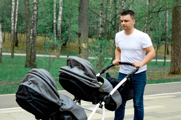 dad-walks-park-with-two-young-children-100894-67