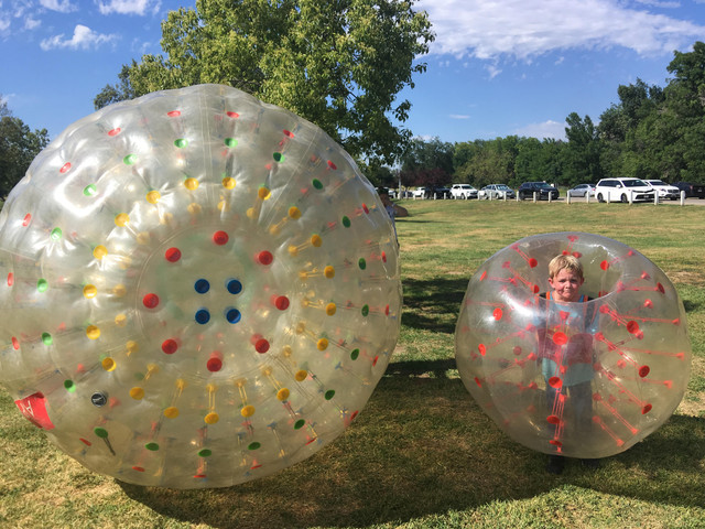 Birthday Boy in a Human Hamster Ball for his Zorbing Party.