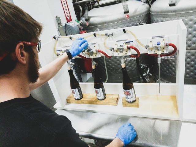 ltb-Funk-Machine-hand-bottling-1-of-3