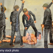 phnom-penh-cambodia-painting-depicting-a-prisoner-tortured-by-khmer-DFXJRP
