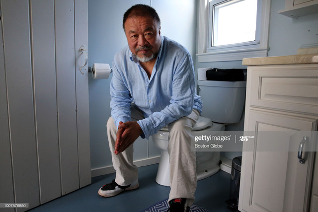 TRURO-MA-JULY-21-Artist-Ai-Weiwei-posses-for-a-portrait-while-visiting-Truro-MA-on-July-21-2018-He-s.jpg