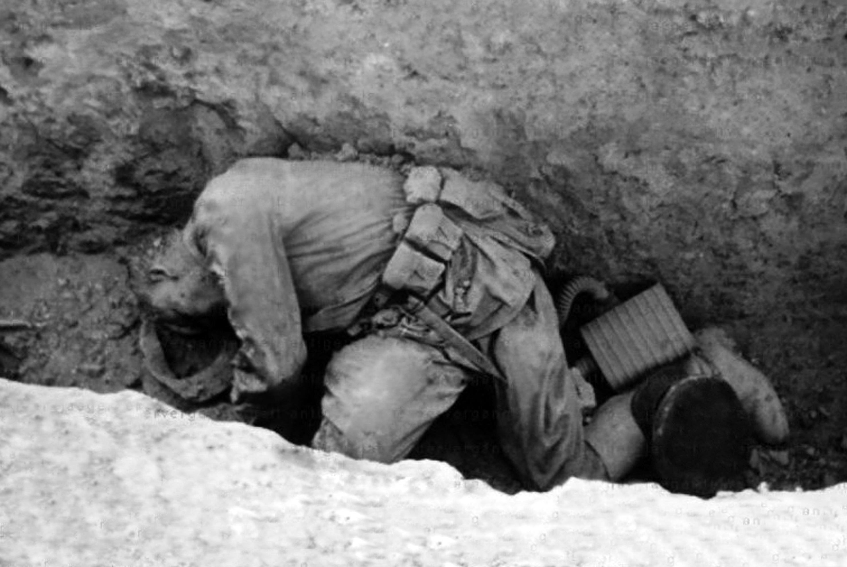 Dead soldier of the Red Army in his trench.