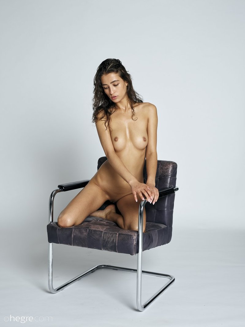 stunning-brunette-hottie-presents-her-perfect-body-on-the-armchair-12-w800