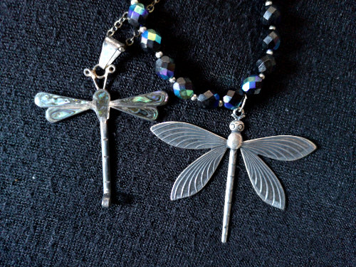 An image of two butterfly pendants.
