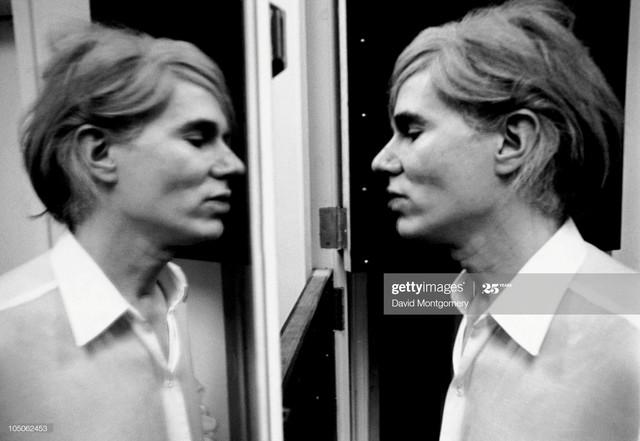 MANDATORY-CREDIT-David-Montgomery-Getty-Images-American-pop-artist-Andy-Warhol-1928-1987-studies-his.jpg