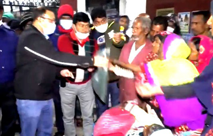 Gaibandha police distributing warm clothes among destitute people