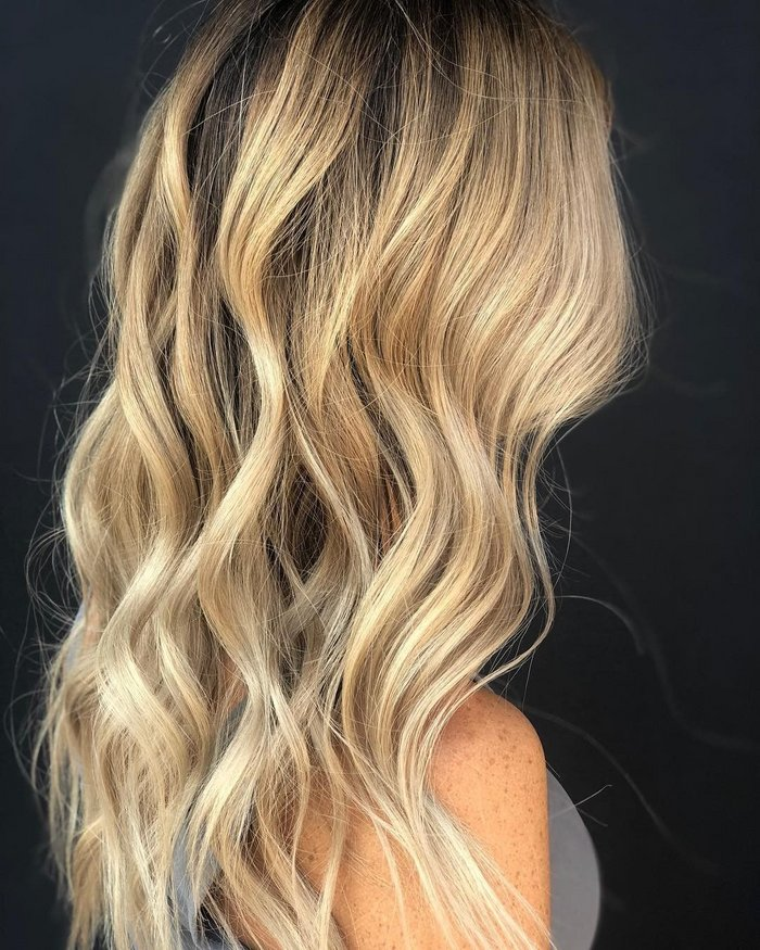 "Balayage expert Georgia Reed, a Malibu C National Educator, says prepping the hair with a Malibu C Crystal Gel Treatment ensures all minerals and impurities are removed for the best balayage lift and deposit. ""Why paint over a dirty wall?"" she says.