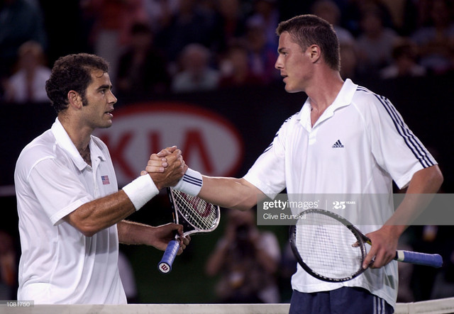 21-Jan-2002-Marat-Safin-of-Russia-right-shakes-hands-after-defeating-Pete-Sampras-of-the-USA-during-