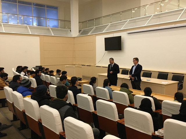 The branch director met with foreign students