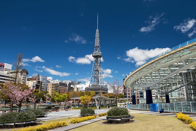 Nagoya-Japan-April-11-2019-urban-view-of-Oasis21-Nagoya-TV-tower-from-Odori-park-with-pink-sakura-or