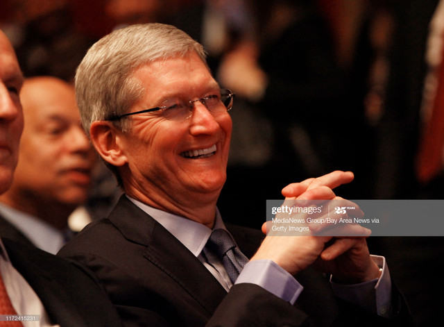 Apple-CEO-Tim-Cook-laughs-from-a-remark-as-President-Barack-Obama-delivers-his-speech-at-the-White-H.jpg