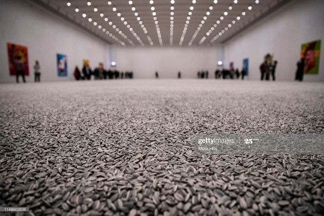 DUSSELDORF-GERMANY-MAY-17-Visitors-are-seen-behind-the-art-installation-Sunflower-Seeds-by-Chinese-a.jpg