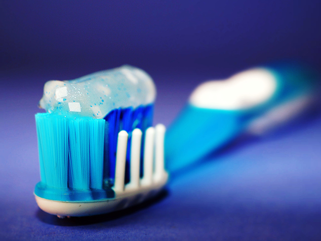 How is brushing teeth related to sexual problems in men?