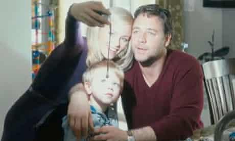 In happier times, John (Russell Crowe) and Lara (Elizabeth Banks) Brennan with Luke (Ty Simpkins)