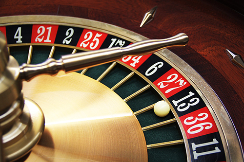 An image of a roulette table, with a ball resting in the '13' slot.
