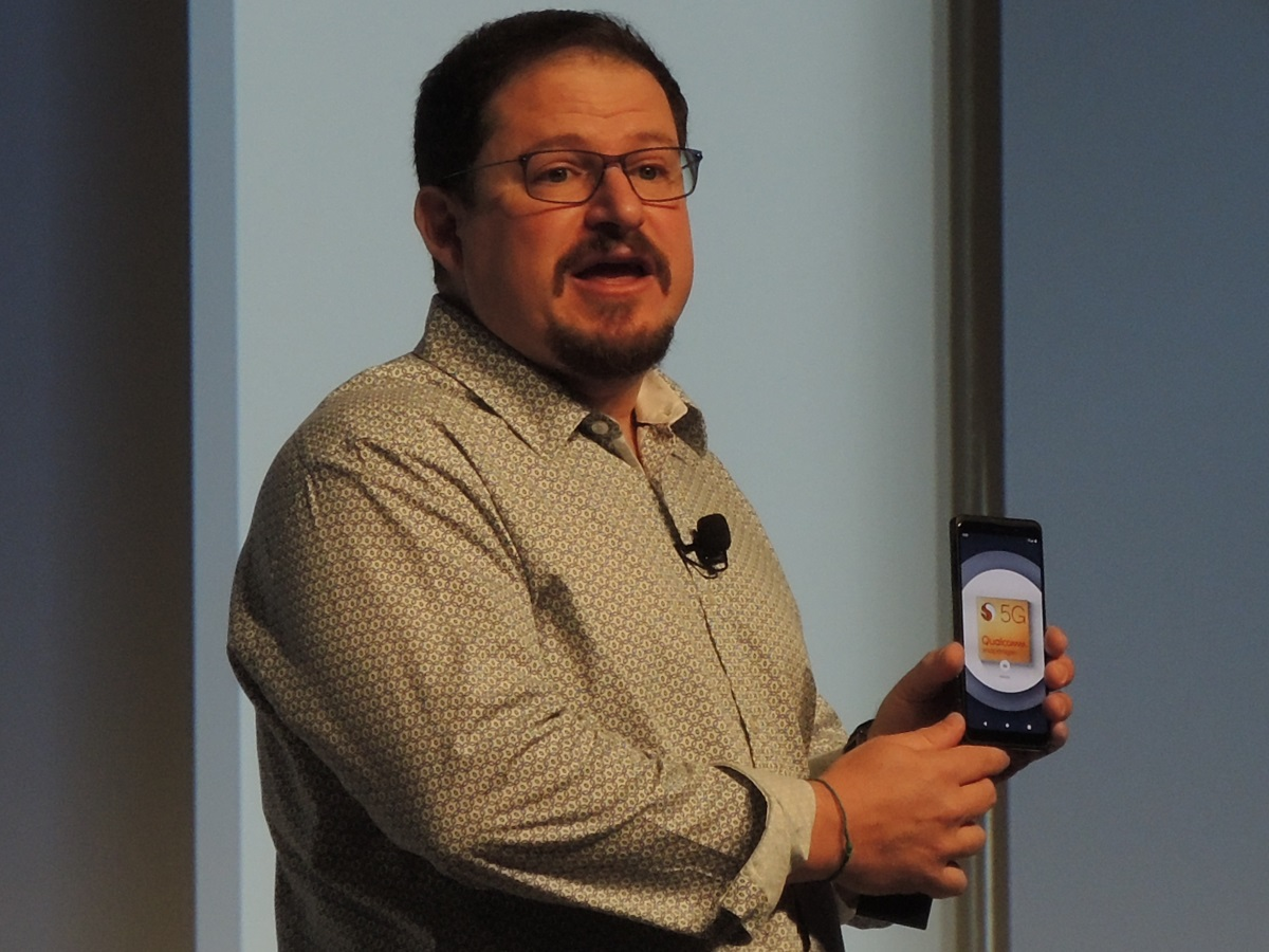 Qualcomm President Cristiano Amon shows the company's reference design for a Snapdragon 855 5G handset. (Photo: EE Times)