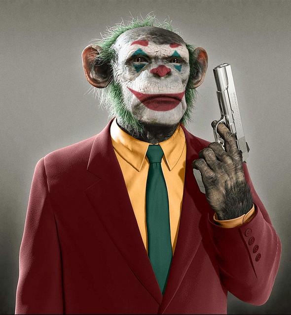 monkey-in-a-suit-w-a-gun.jpg