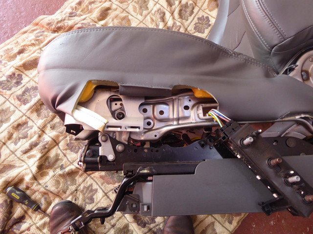 Passenger-seat-control-box-unscrewed-from-seat-chassis.jpg