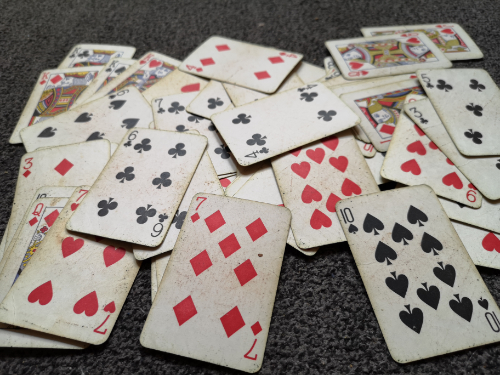 An image of scattered playing cards
