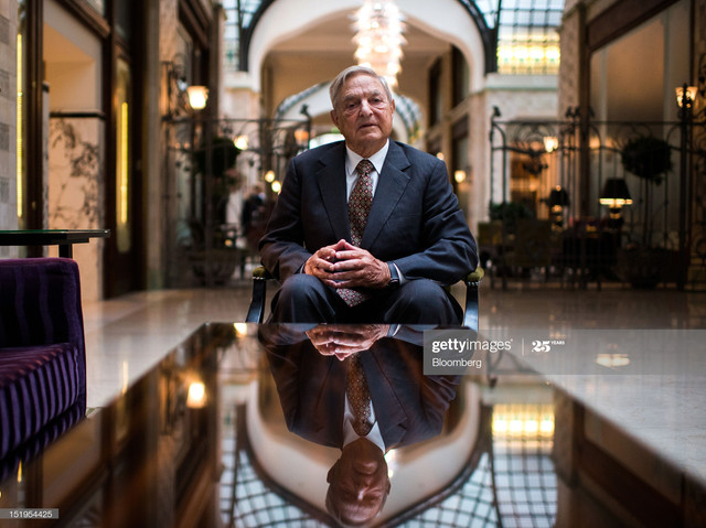 George-Soros-founder-of-Soros-Fund-Management-LLC-poses-for-a-photograph-following-a-Bloomberg-Telev.jpg