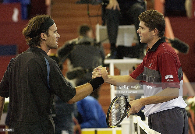 MADRID-OCTOBER-17-Jiri-Novak-R-of-the-Czech-Republic-and-Carlos-Moya-of-Spain-shake-hands-after-thei