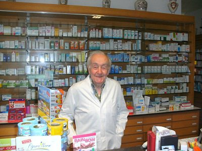 Otto Carius at his workplace in his personal pharmacy