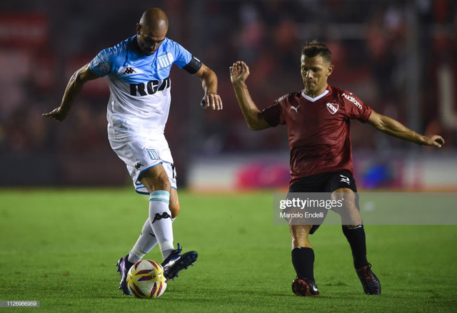 AVELLANEDA-ARGENTINA-FEBRUARY-23-Lisandro-Lopez-of-Racing-Club-kicks-the-ball-against-Nicol-s-Doming