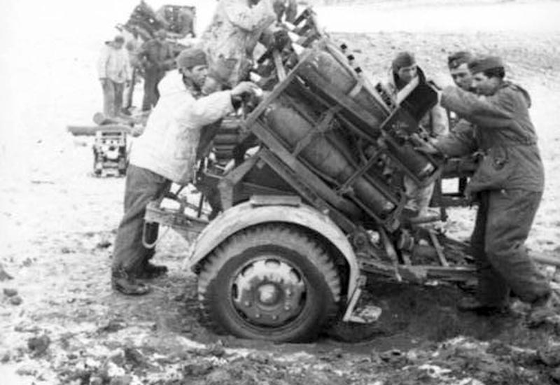 German soldiers load the Nebelwerfer rocket launcher