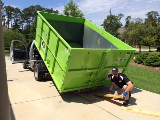 Residential Friendly Dumpster Rentals with driveway protection policy.