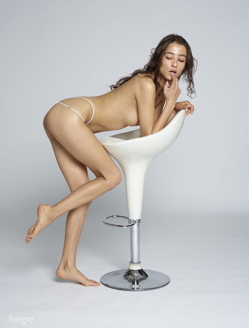 brunette-with-nice-sexy-slim-body-takes-off-her-white-lingerie-on-the-chair-09-w800