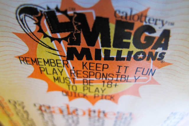 A-lottery-ticket-for-the-current-record-breaking-667-million-U-S-Mega-Millions-jackpot-is-shown-in-t