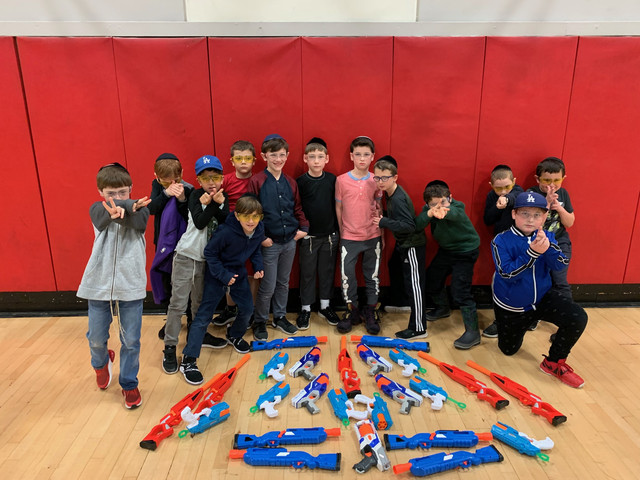 Group-of-Boys-After-Their-Nerf-Birthday-Party-in-an-indoor-nerf-arena-in-Los-Angeles