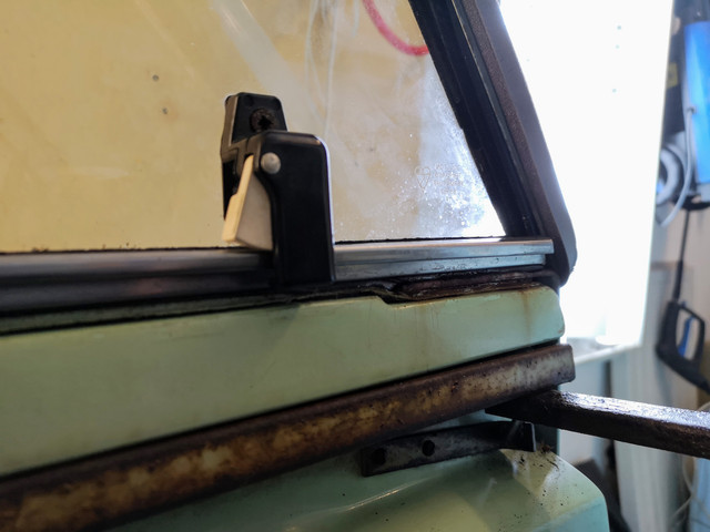 Have added an additional foam rubber seal between the window runner and (interior edge of) the door top.  Hopefully this will help convince the rain to stay outside.