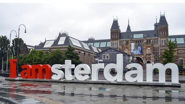 cartel-amsterdam-travelmarathon-es