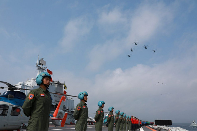 2018-04-134-CHINA-MILITARY-XI-South-China-Sea