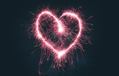 An image of a heart drawn with a sparkler.