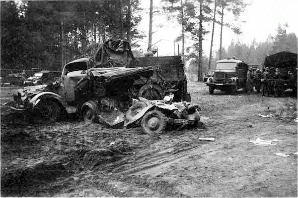 T34 and KV-1 ramming a German convoy Destroyed german car and truck